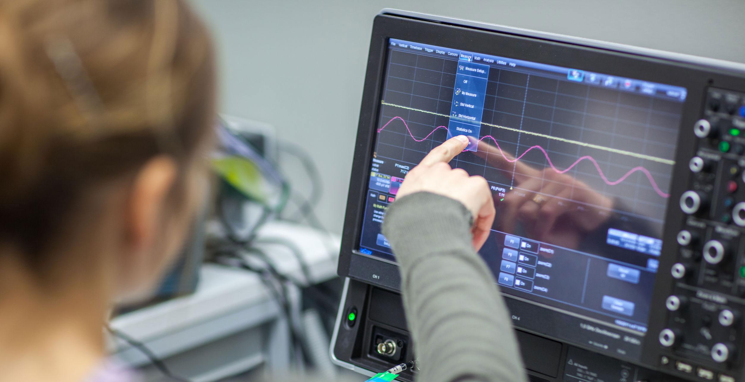 Laser technician in an aerospace lab